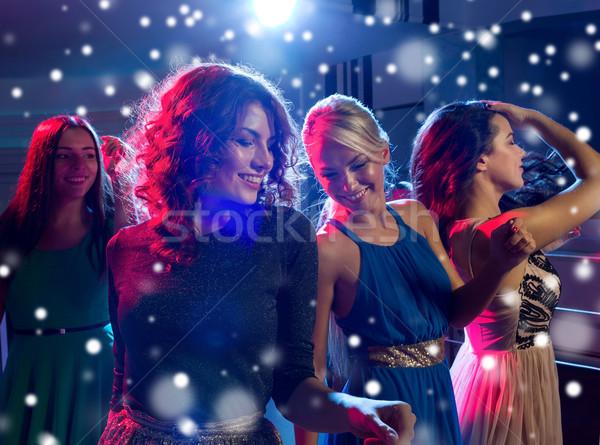 улыбаясь друзей танцы клуба Новый год вечеринка Сток-фото © dolgachov