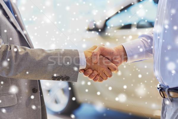 close up of male handshake in auto show or salon Stock photo © dolgachov