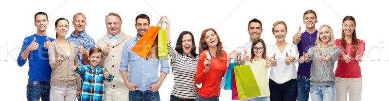 Stock fotó: Boldog · emberek · bevásárlótáskák · mutat · remek · kézmozdulat · vásár