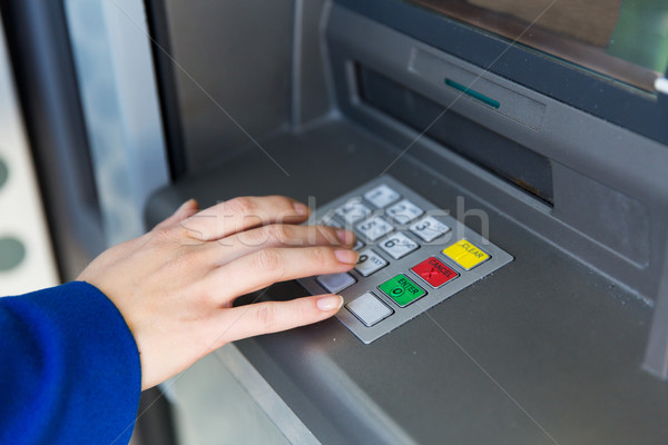 close up of hand entering pin code at cash machine Stock photo © dolgachov