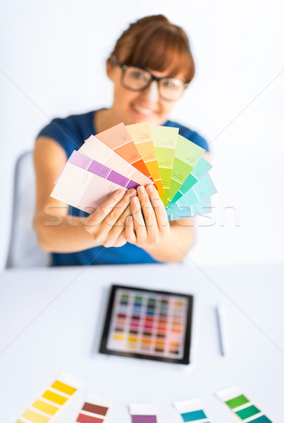 woman showing pantone color samples Stock photo © dolgachov