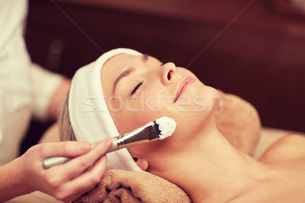 close up of young woman and cosmetologist in spa Stock photo © dolgachov