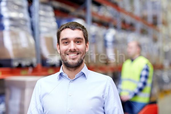 businessman over warehouse loader on forklift  Stock photo © dolgachov