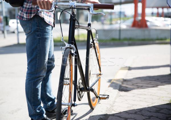 close up of man and fixed gear bike on city street Stock photo © dolgachov