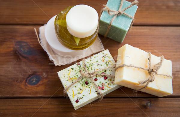 close up of handmade soap bars on wood Stock photo © dolgachov