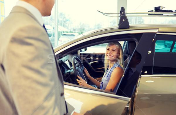Heureux femme Auto montrent salon Photo stock © dolgachov