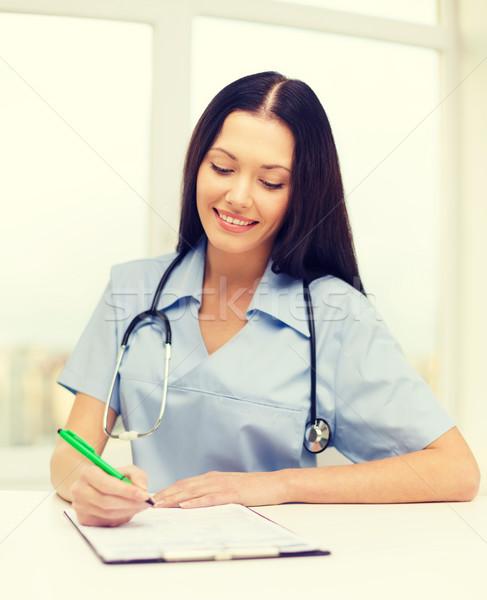 Foto stock: Femenino · médico · enfermera · escrito · medicamentos · recetados · salud