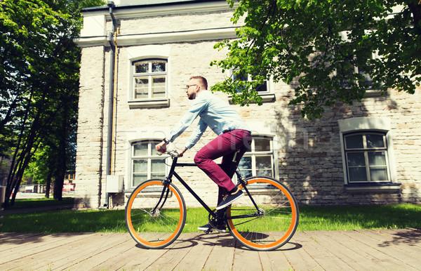 Feliz jovem homem equitação fixo Foto stock © dolgachov