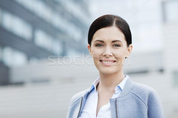 Fiatal mosolyog üzletasszony irodaház üzletemberek nő Stock fotó © dolgachov