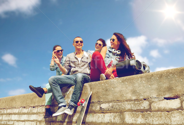 group of smiling teenagers hanging out Stock photo © dolgachov