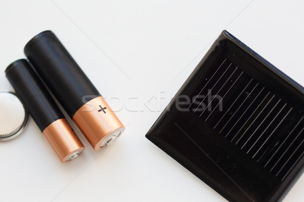 close up of alkaline batteries and solar cell Stock photo © dolgachov
