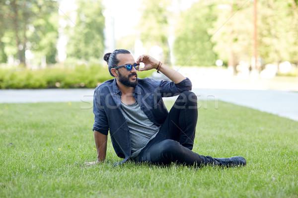 man in sunglasses at city street or park Stock photo © dolgachov