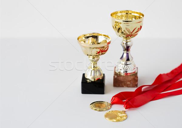 Közelkép sportok arany csészék medálok sport Stock fotó © dolgachov
