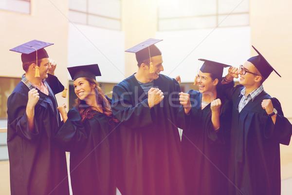 Grupy uśmiechnięty studentów edukacji ukończeniu ludzi Zdjęcia stock © dolgachov