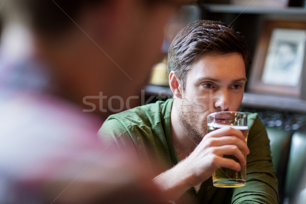 happy man with friend drinking beer at bar or pub Stock photo © dolgachov
