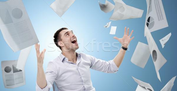 Empresário queda documentos pessoas de negócios sucesso azul Foto stock © dolgachov