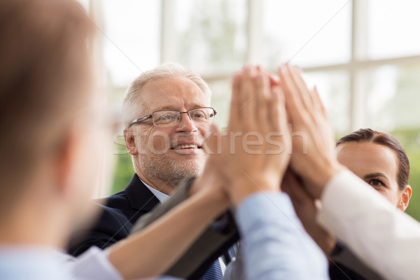 business people making high five in office Stock photo © dolgachov