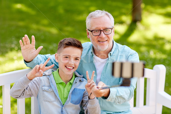 old man and boy taking selfie by smartphone stock photo syda productions d. Black Bedroom Furniture Sets. Home Design Ideas