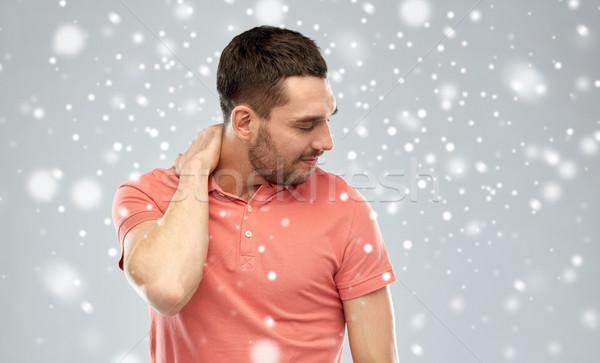 Mutsuz adam boyun ağrısı kar insanlar Stok fotoğraf © dolgachov