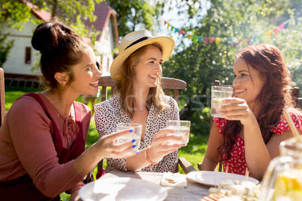 happy women with drinks at summer garden party Stock photo © dolgachov