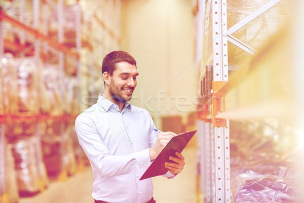 счастливым бизнесмен буфер обмена склад оптовая торговля бизнеса Сток-фото © dolgachov
