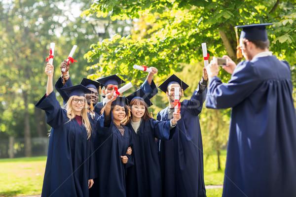 Estudiantes solteros educación graduación Foto stock © dolgachov