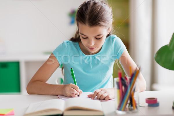 Stock foto: Mädchen · glücklich · Buch · schriftlich · Notebook · home · Menschen