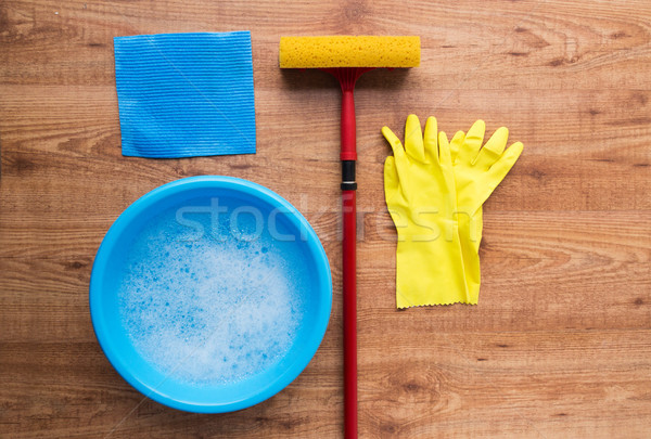 basin with cleaning stuff on wooden background Stock photo © dolgachov