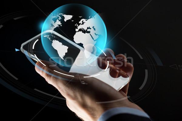 Stock fotó: üzletember · kéz · okostelefon · Föld · üzlet · tömeg