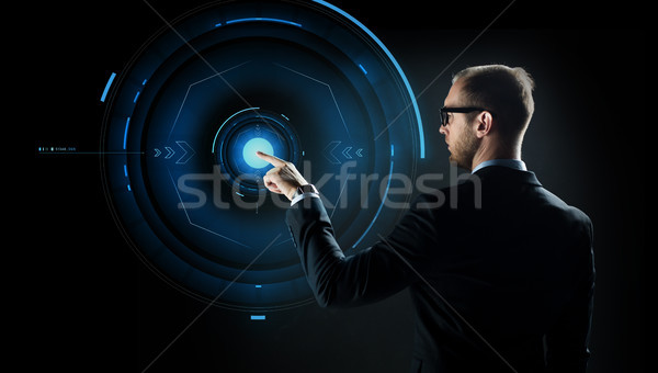 businessman pointing finger to virtual projection Stock photo © dolgachov