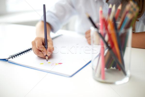 Lány rajz színesceruza toll notebook művészet Stock fotó © dolgachov