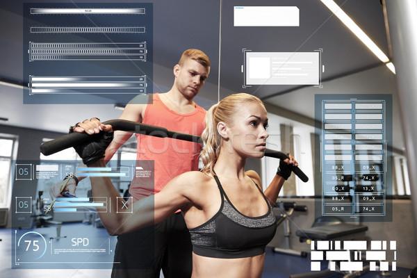 ストックフォト: 男 · 女性 · 筋肉 · ジム · マシン · スポーツ
