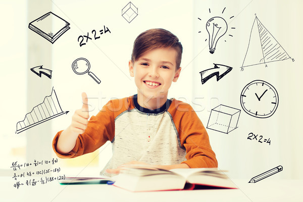 happy student boy with textbook showing thumbs up Stock photo © dolgachov
