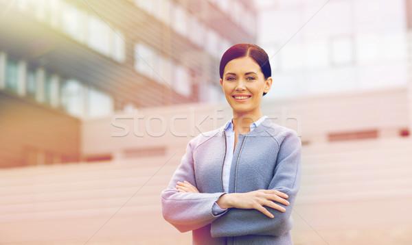 Giovani sorridere imprenditrice edificio per uffici uomini d'affari donna Foto d'archivio © dolgachov