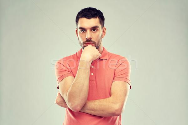man thinking over gray background Stock photo © dolgachov