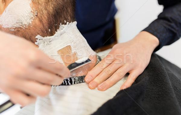Adam berber düz ustura sakal insanlar Stok fotoğraf © dolgachov