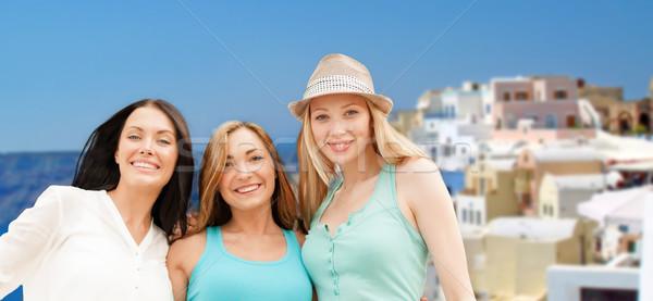 Boldog nők Santorini sziget utazás turizmus Stock fotó © dolgachov