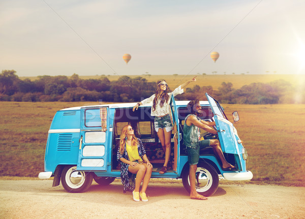 happy hippie friends in minivan car in africa Stock photo © dolgachov