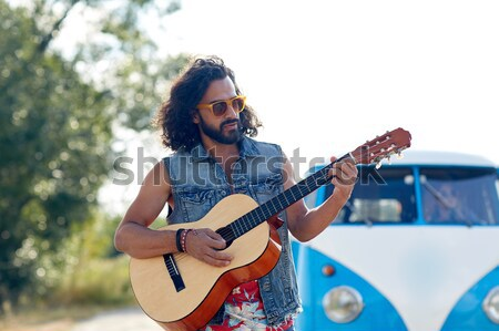 hippie man playing guitar at minivan car outdoor Stock photo © dolgachov