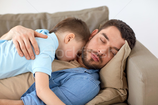 Stock photo: happy father and son sleeping on sofa at home