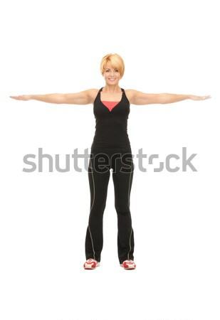 Fitness istruttore luminoso foto bianco donna Foto d'archivio © dolgachov