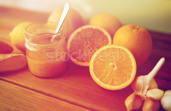Mel cítrico frutas gengibre alho madeira Foto stock © dolgachov