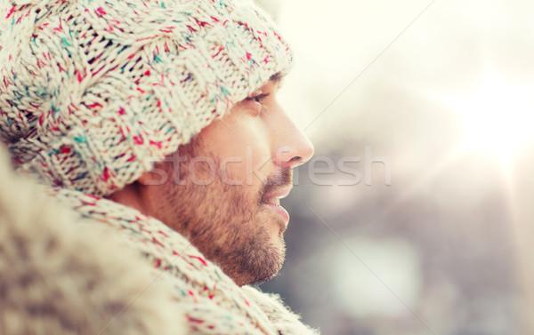 face of happy man outdoors in winter Stock photo © dolgachov