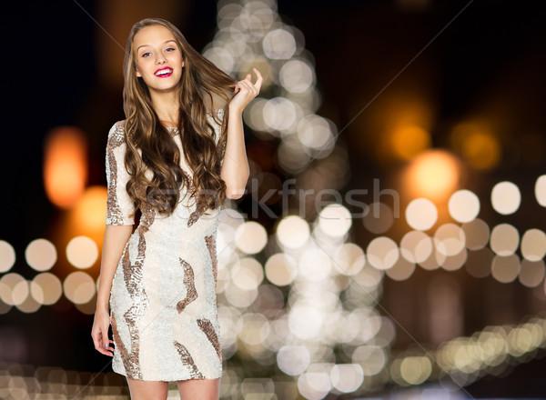 happy young woman over christmas tree lights Stock photo © dolgachov