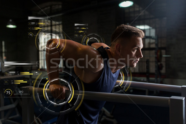 man doing triceps dip on parallel bars in gym Stock photo © dolgachov