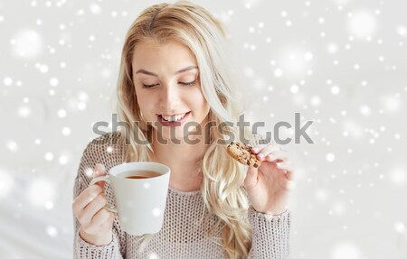 happy woman with cup of coffee in bed at home Stock photo © dolgachov