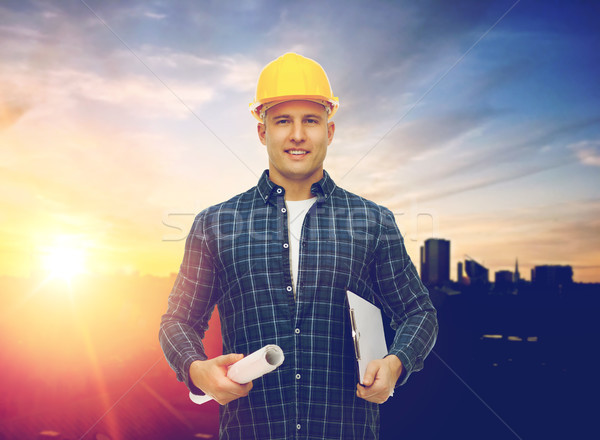 builder in hard hat with blueprint and clipboard Stock photo © dolgachov