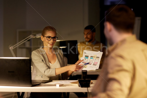 workers with user interface mockup late at office Stock photo © dolgachov