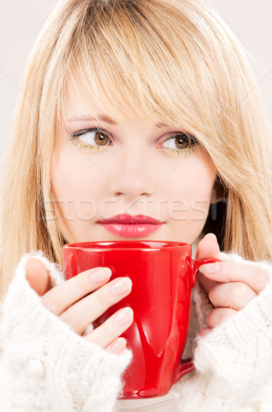 lovely teenage girl with red mug Stock photo © dolgachov