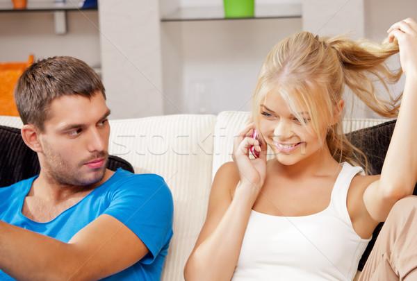 couple with cellphone Stock photo © dolgachov